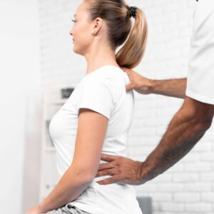 male-physiotherapist-checking-woman-s-back